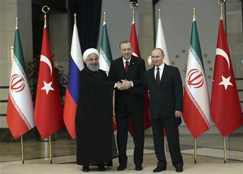 Putin, Rohani i ErdoganFoto: Tolga Bozoglu/Pool Photo via AP