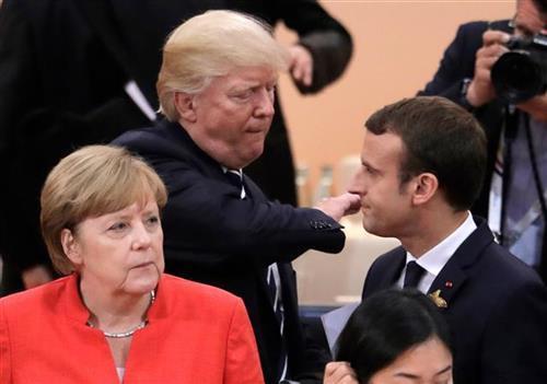 Merkel, Makron, Tramp Foto: AP Photo/Markus Schreiber