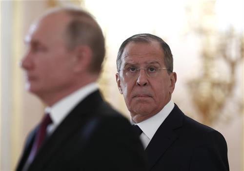 Lavrov i Putin Sergei Karpukhin/Pool Photo via AP