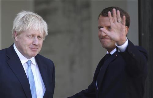Džonson i Makron Foto: AP Photo/Daniel Cole
